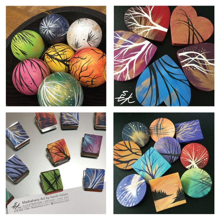 Samples of painted crafts: ball ornaments, wooden hearts, wood magnet clips and pins
